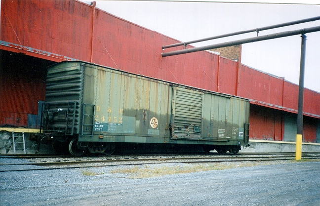 On 'Conveyance Day,' the D&H inherited 295 50ft steel 'XL' box cars (numbered 24401 - 24696) from the Reading Railroad. Most of these box cars retained the Reading green paint, while the RDG reporting marks were painted out with a light green paint and the D&H marks applied over them.  Photo from the Jim Odell collection, used by permission.
