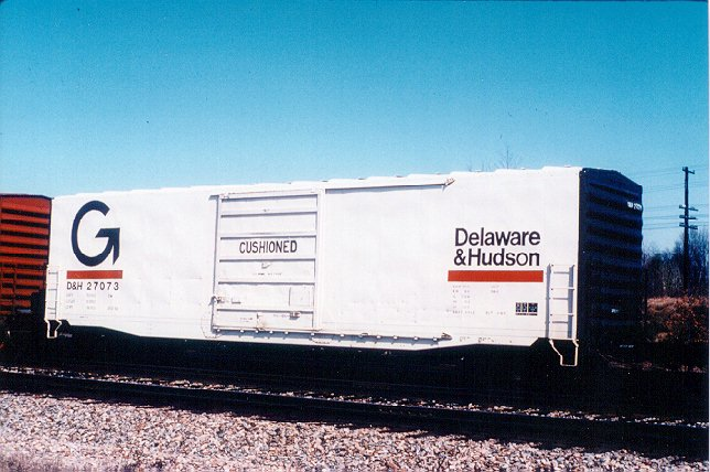 Under the Guilford reign, most of D&H's locomotives were repainted into the Grey and Orange scheme, or into the MEC Orange scheme, but only one D&H box car was ever painted in the 'Big G' scheme. 27073 is shown in pristine condition at Saratoga Springs in March 1983.  Photo from a Bill Mischler 35mm slide, used by permission.