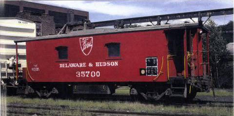 D&H 35700   The first in the series and the last in service. Sans cupola, the car is seen in new Spartan lettering with a gray roof at Colonie in July, 1981.  Photo by Tony Hodun.