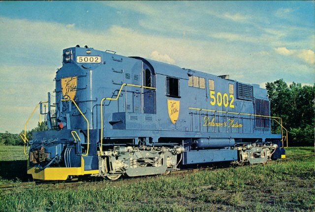 """D&H 5002  Jim Shaughnessy found RS-11 #5002 in Voohreesville, NY Industrial Park, August 18,1977, shortly after it was repainted in the solid blue paint scheme known as """"Altschul blue"""" after Selig Altschul, then President of the D&H.  Photo by Jim Shaughnessy"""