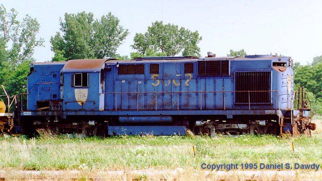 D&H 5002  Many years later and much worse for wear, the RS-11 #5002 is only days away from the scrapper as shown by the photograph taken byDan Dawdyin the National Railway Equipment yard in Moline, IL where he was taking photographs for the NYSW June 22, 1995.  Photo by Dan Dawdy