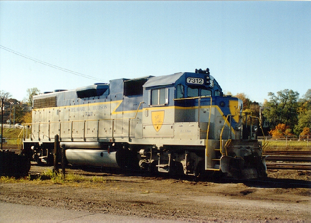 D&H 7325 (CP 7312)  7312 is named for D&H Road Foreman Bernie O'Brien (B.C. O'Brien) and is shown basking in the late afternoon sun at Kenwood Yard, Albany, NY in late October 1990.  Photo by Neil C. Hunter.