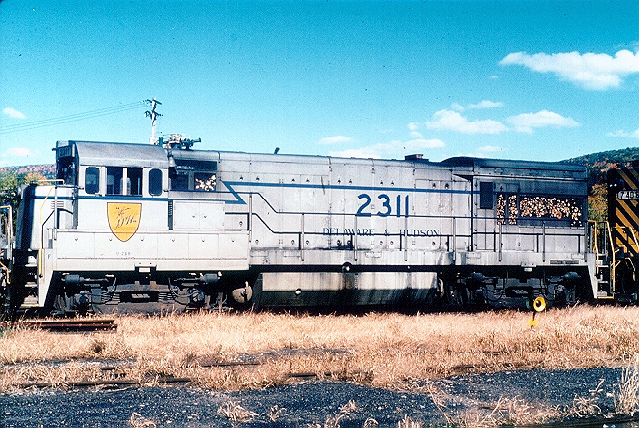 D&H 2311  Know by railfans as the 'Grey Ghost', at a time when the predominant color in the D&H was blue, someone decided to use the surplus grey paint at Colonie, and #2311 is the result. At Oneonta, NY in October 1981.   Bill Mischler photo