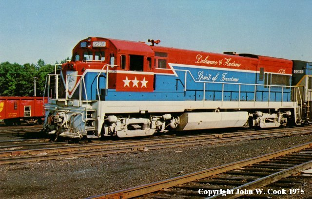 D&H 2312 (1776)  One of the D&H contributions to the American Bicentennial was the unit #1776, shown here on the ready track at Rouses Point, NY in June of 1975. The U23B was delivered as #2312 and later renumbered to 1776 for the bicentennial. It was later renumbered back to its original number.  Photograph by John W. Cook