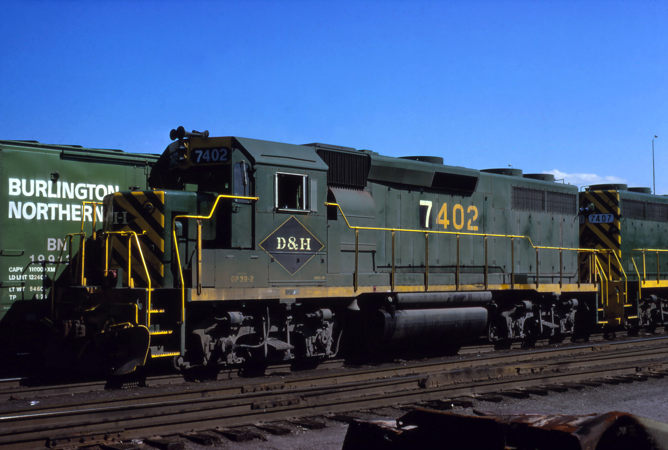D&H GP39-2 #7402 lays over in Binghamton, NY on July 22, 1976.  The Garbely Publishing Company collection