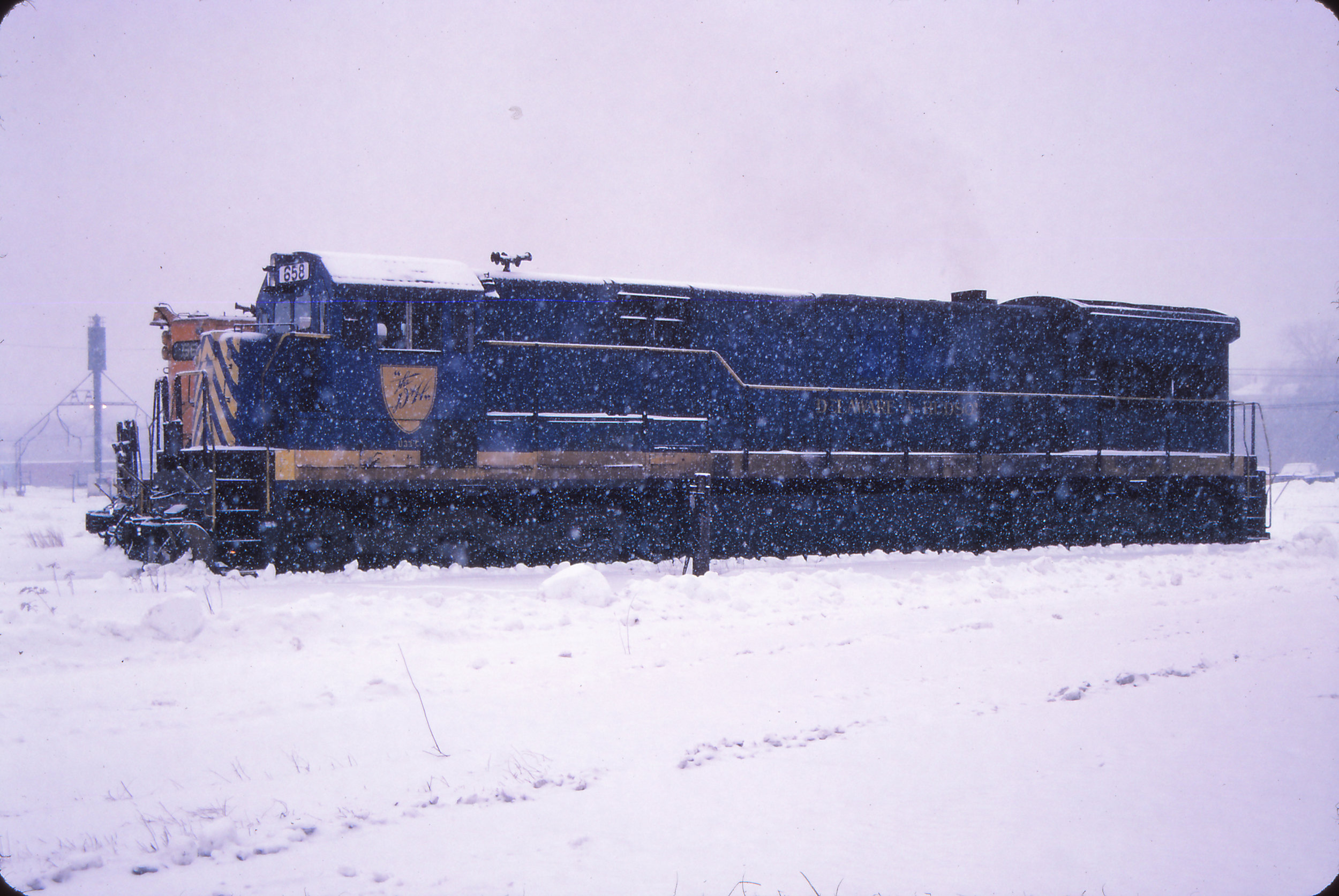 In December of 1987, D&H U33C 758 has been renumbered to 658 by Guilford, but still wears its coat of D&H blue. It was the only U33C to be so painted by the D&H. It is seen here in the former Maine Central Rigby Yard in Portland, ME.  Brian E. Loss photo, The Garbely Publishing Company collection