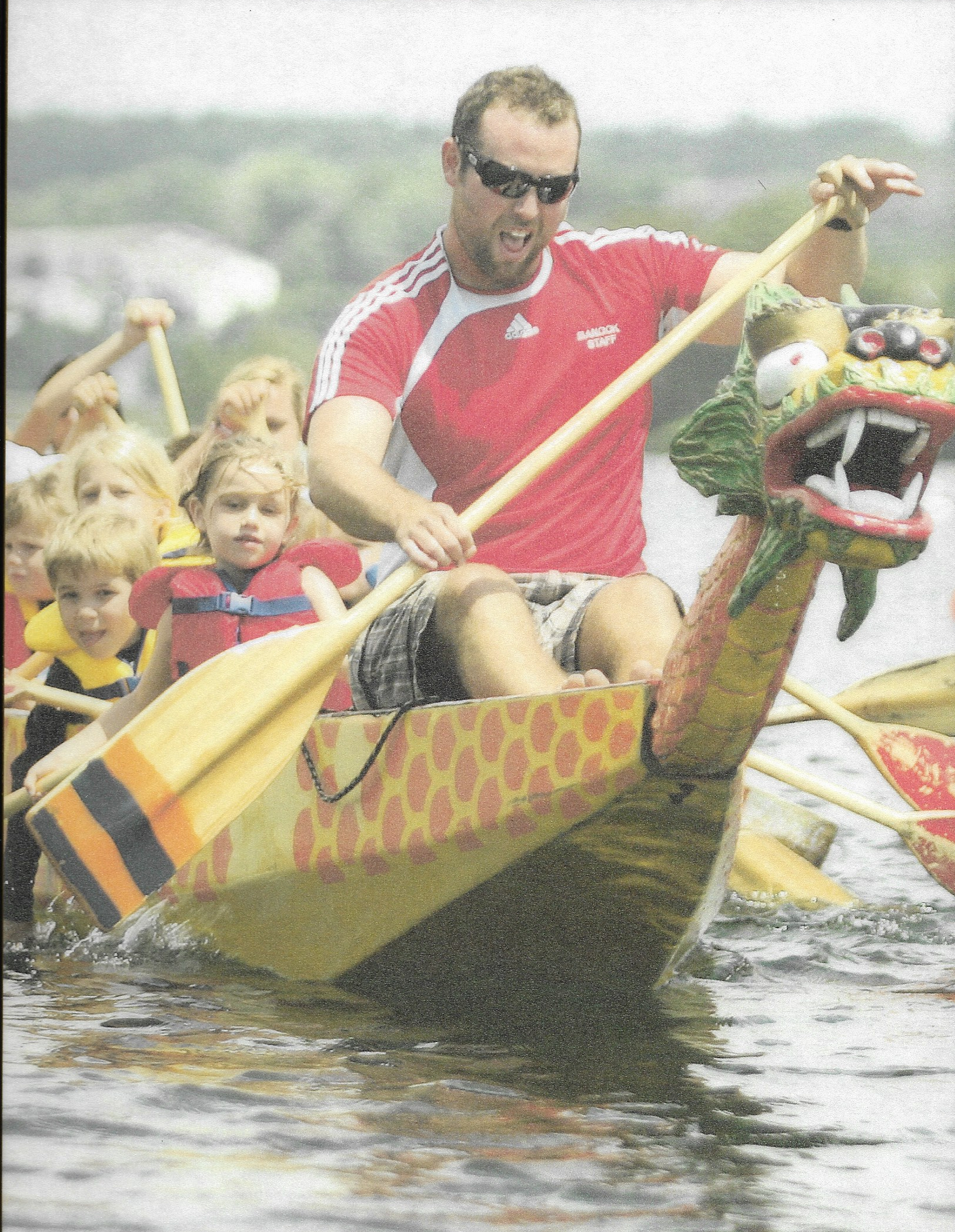Joe Starr, stroking a dragon boat full of young paddlers.