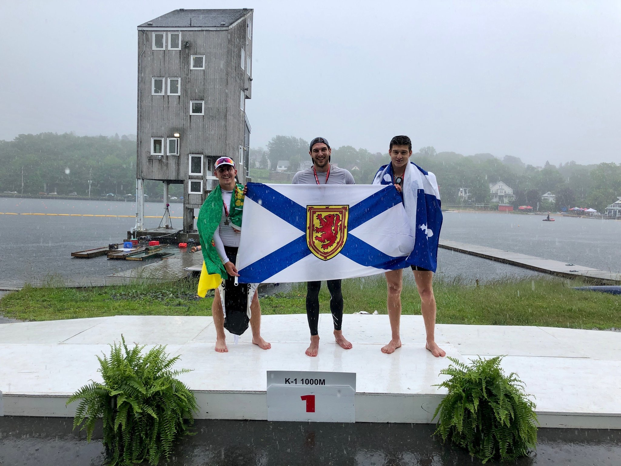 Marshall Hughes (NS) tops the podium with Jarret Kenke (SASK) in second place and Laurent Lavinge (QUE) for Men K-1 1000m. Hughes and Kenke later won the Men K-2 1000m.