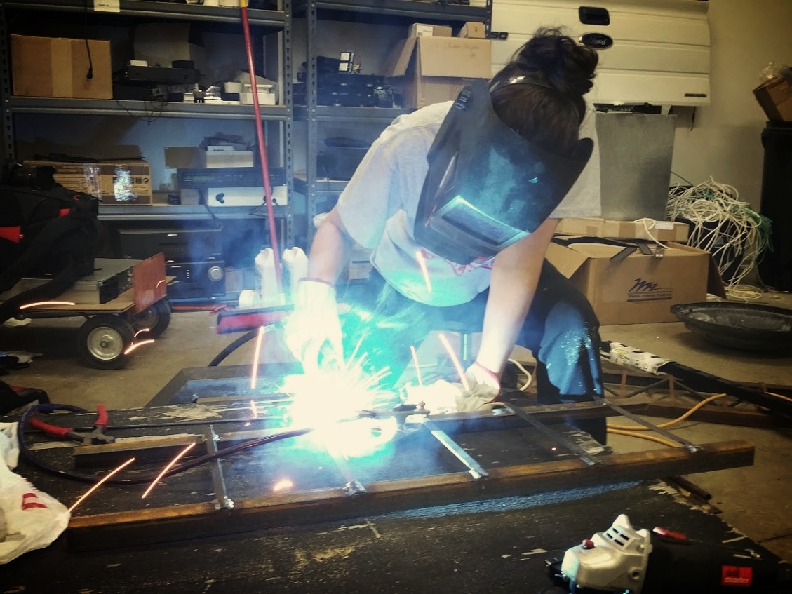 Lindsay making ramps for motorcycle trailer