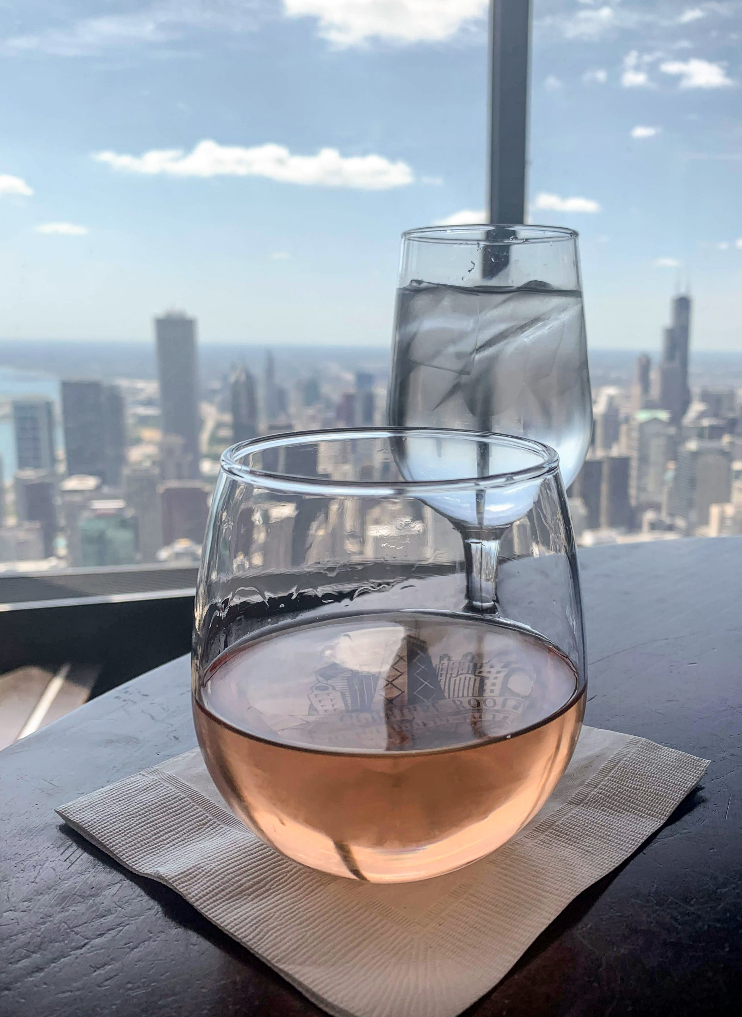 This time she was rosé on the 96th floor of the John Hancock Building with views as far as the eyes could see, a long walk down The Magnificent Mile, along the Chicago River, and through the theatre district, an amazing performance of   Hamilton  , and drinks at the Palmer House.