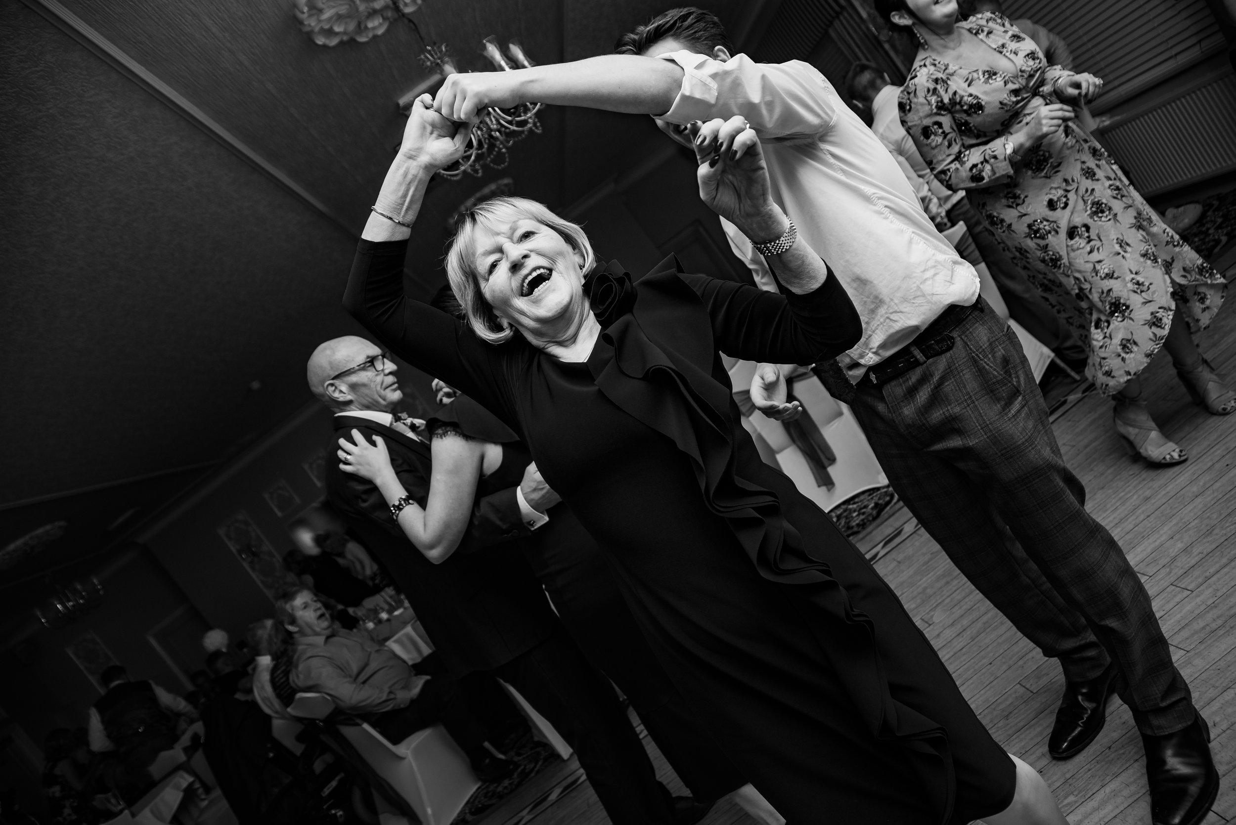 black and white dancing wedding photography dana lewis