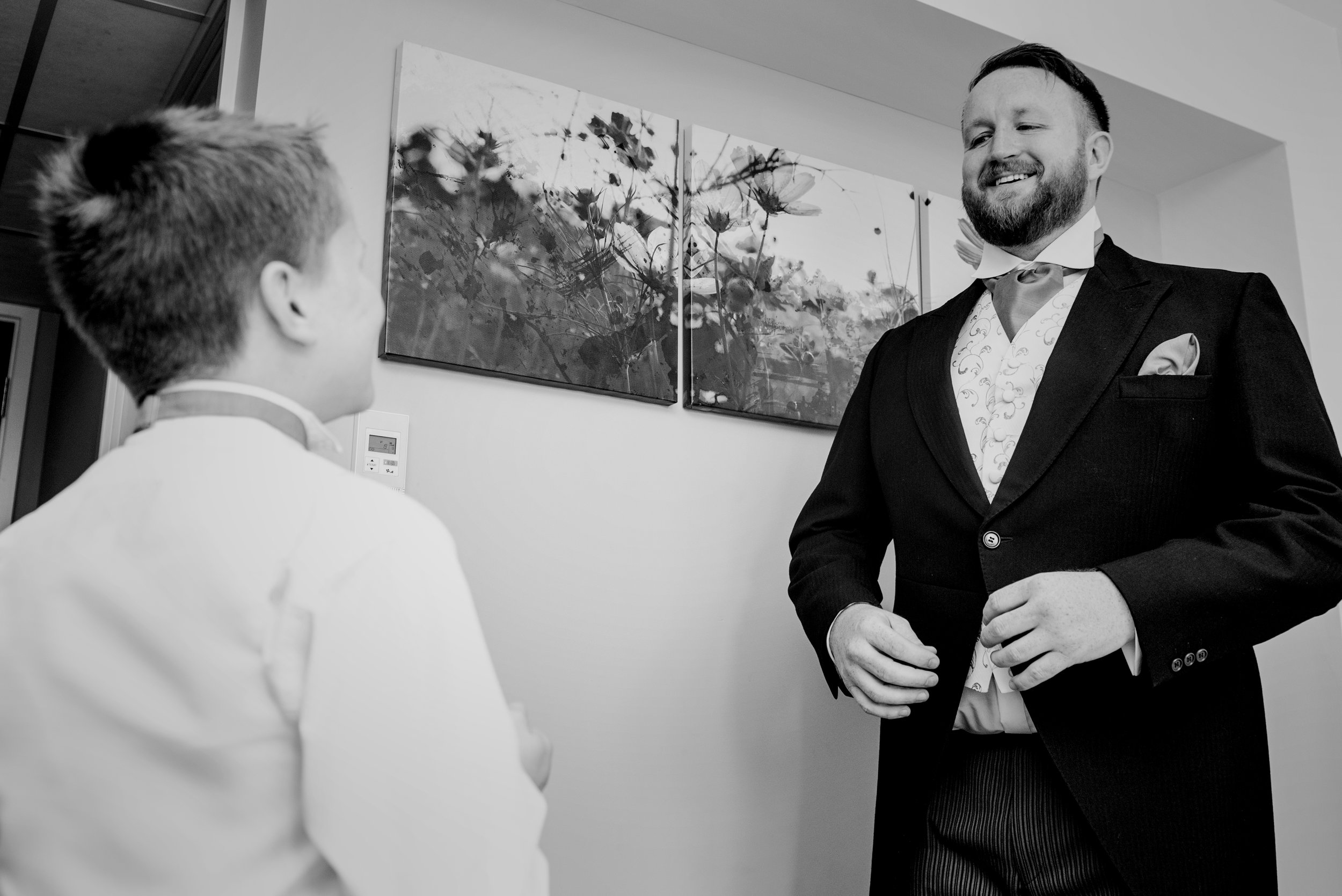 Groom and his son having an amazing moment wedding day