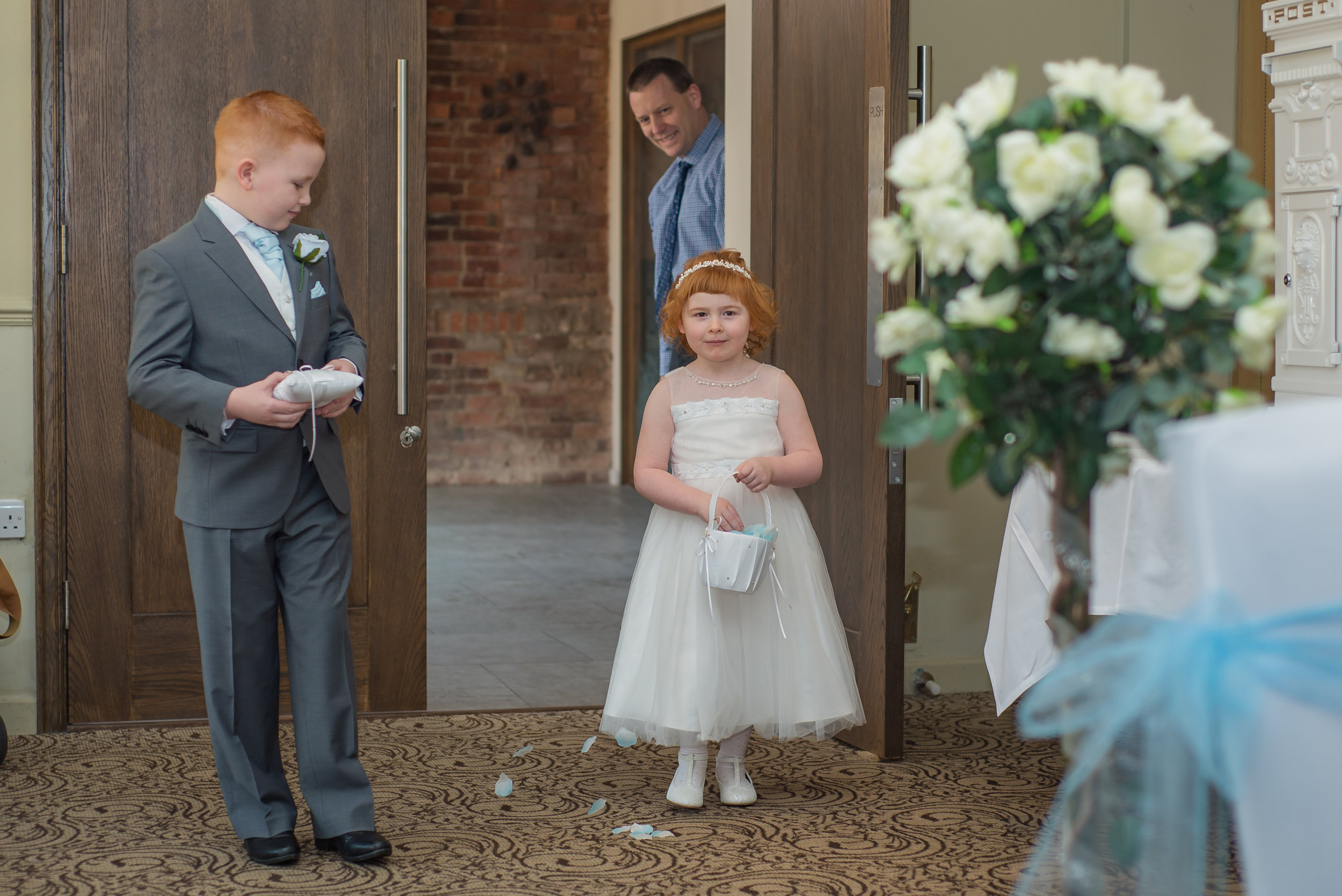 wedding photography and wedding videography, flowergirl and page boy walking down the aisle