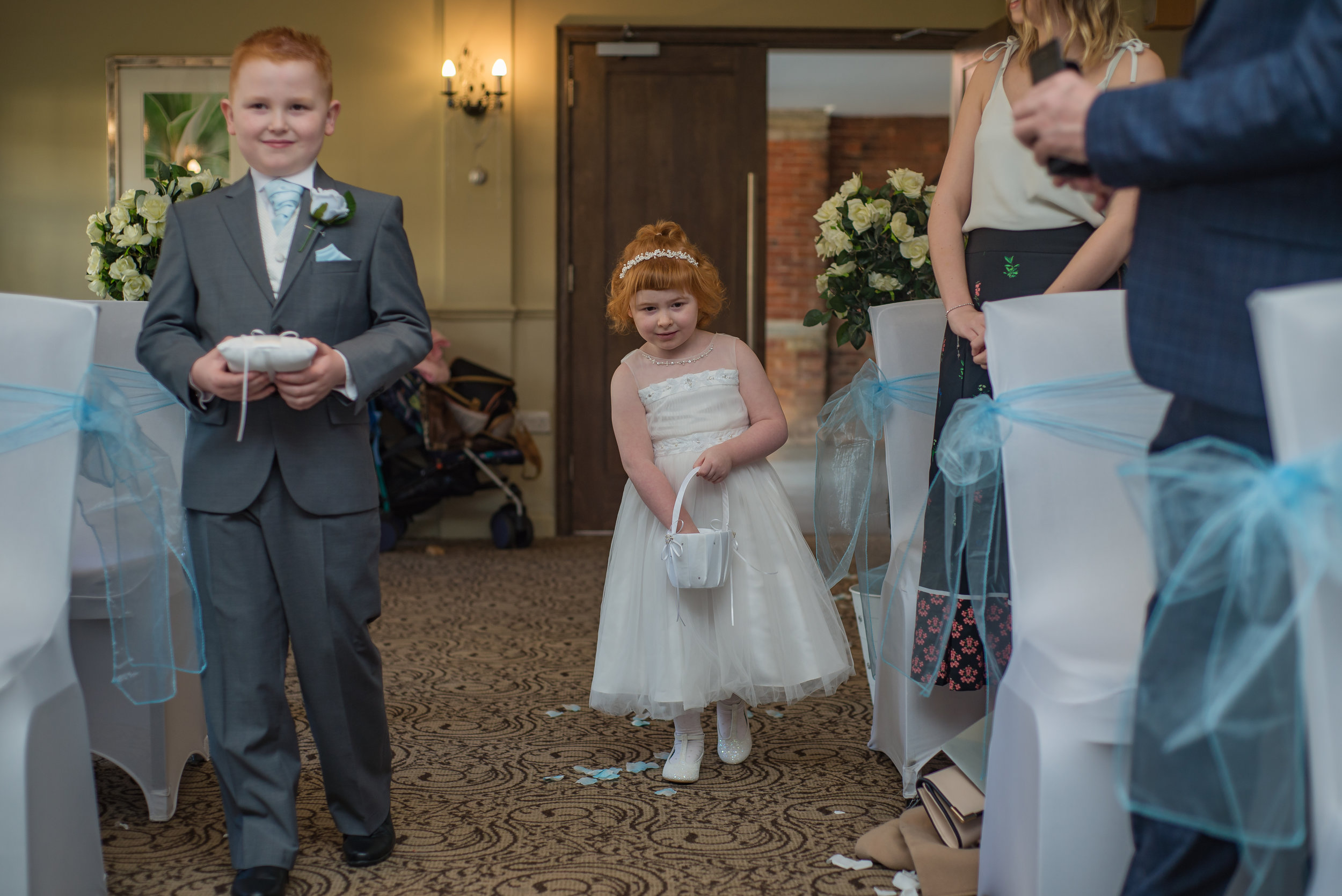 wedding photography and wedding videography, walking down the aisle, children,