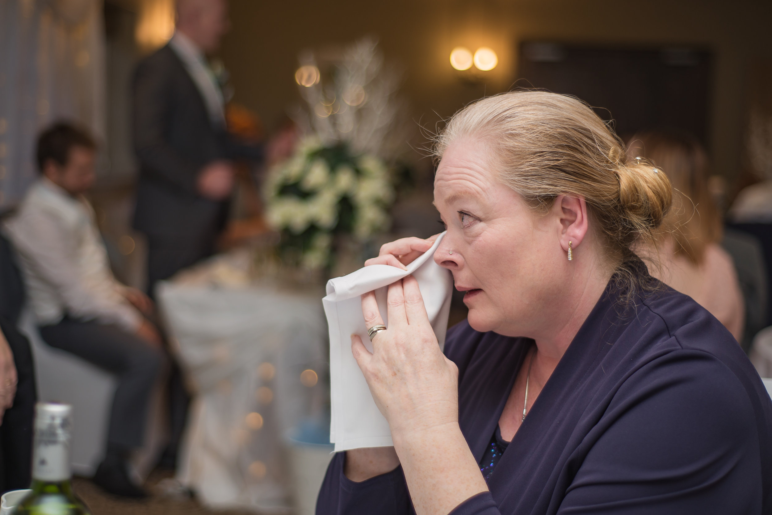wedding photography and wedding videography, emotional mother of the groom crying over grooms speech