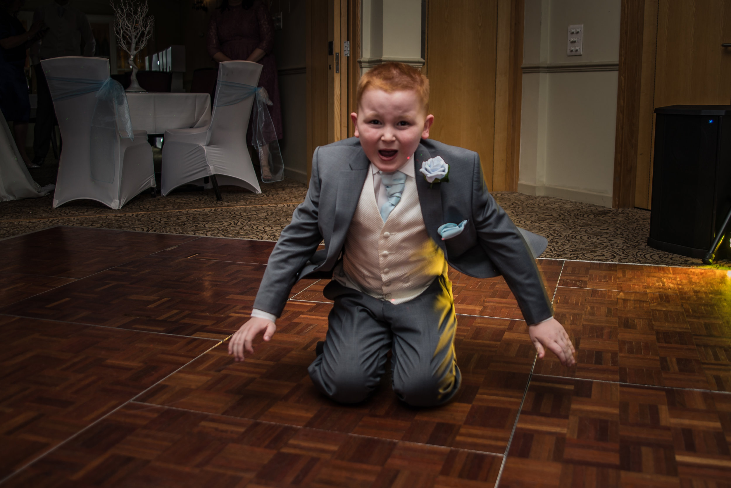 wedding photography and wedding videography, slide on the dancefloor