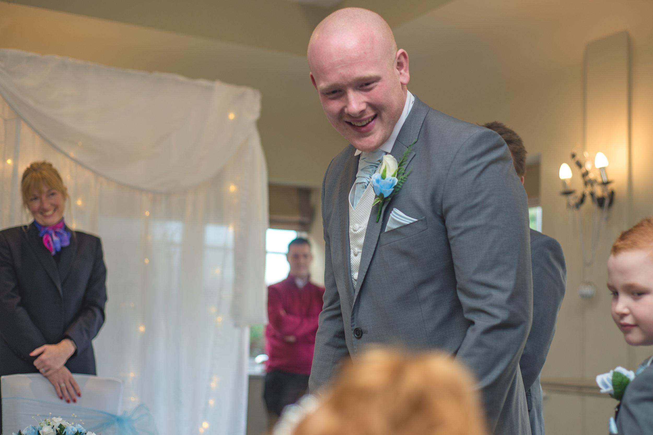wedding photography and wedding videography, groom sees his daughter for the first time