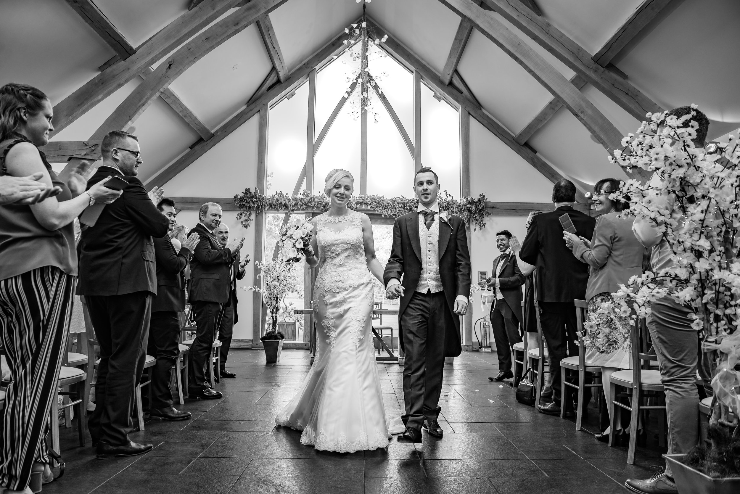 black and white wedding photography leaving as husband and wife
