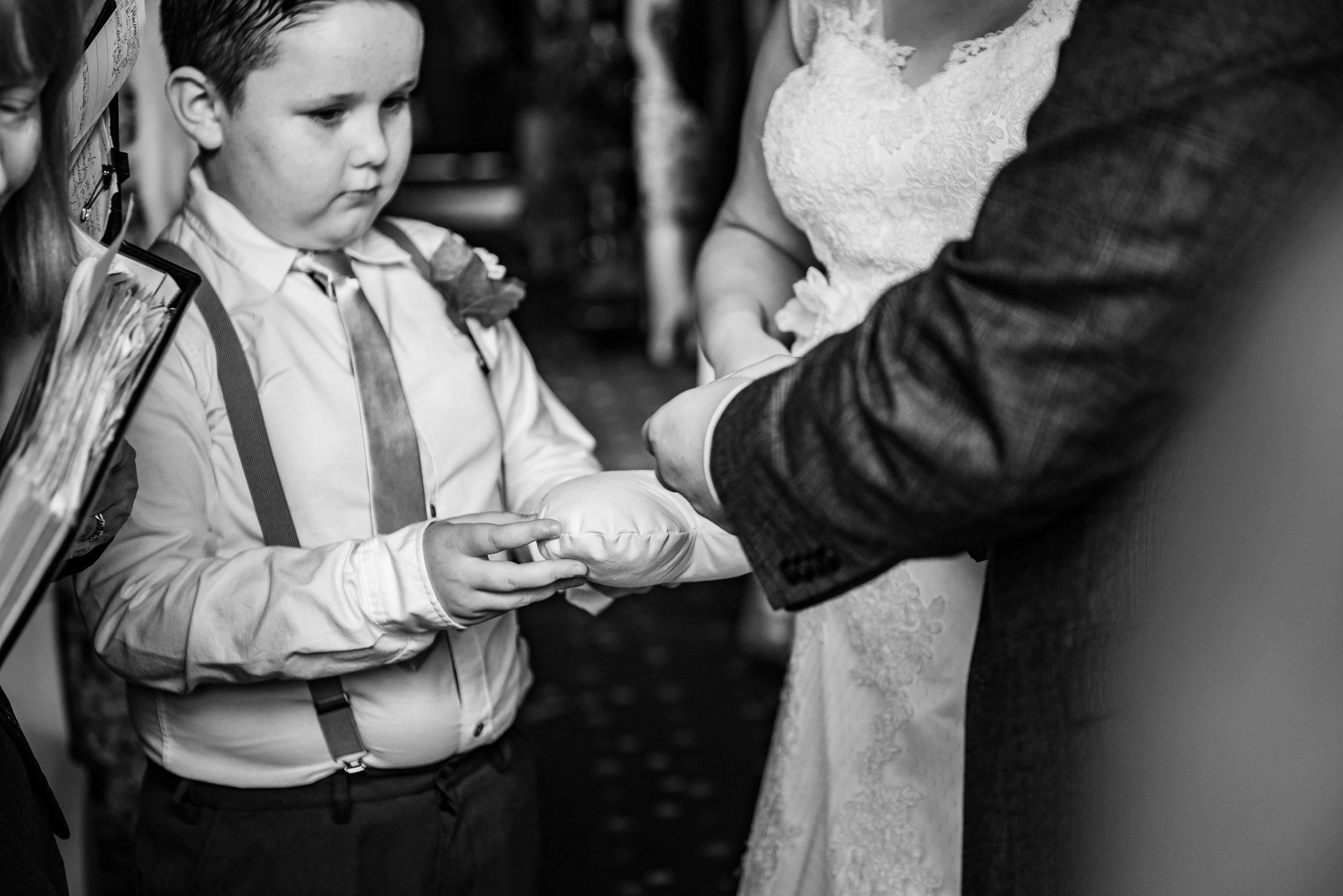 black and white wedding photography ring bearer