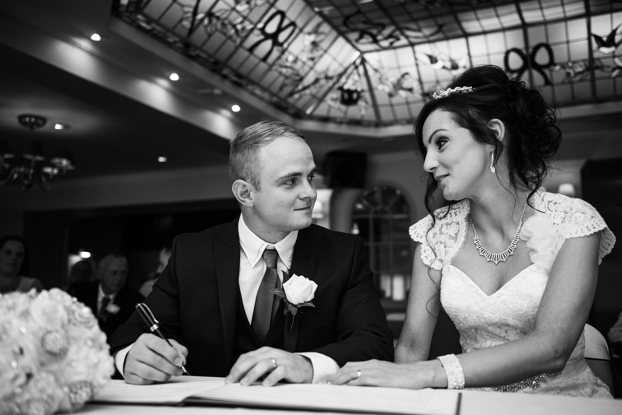black and white wedding photography signing the register