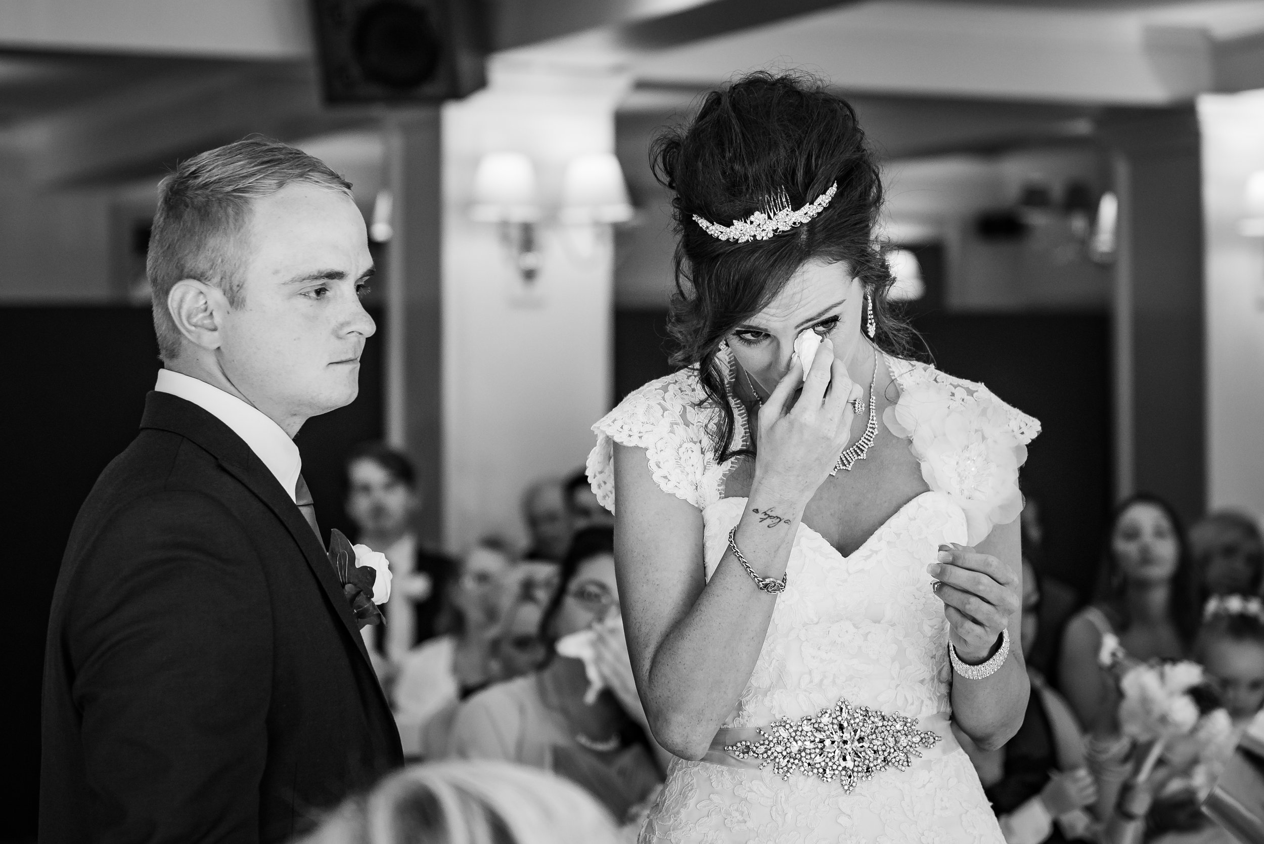 black and white wedding photography emotional bride ceremony