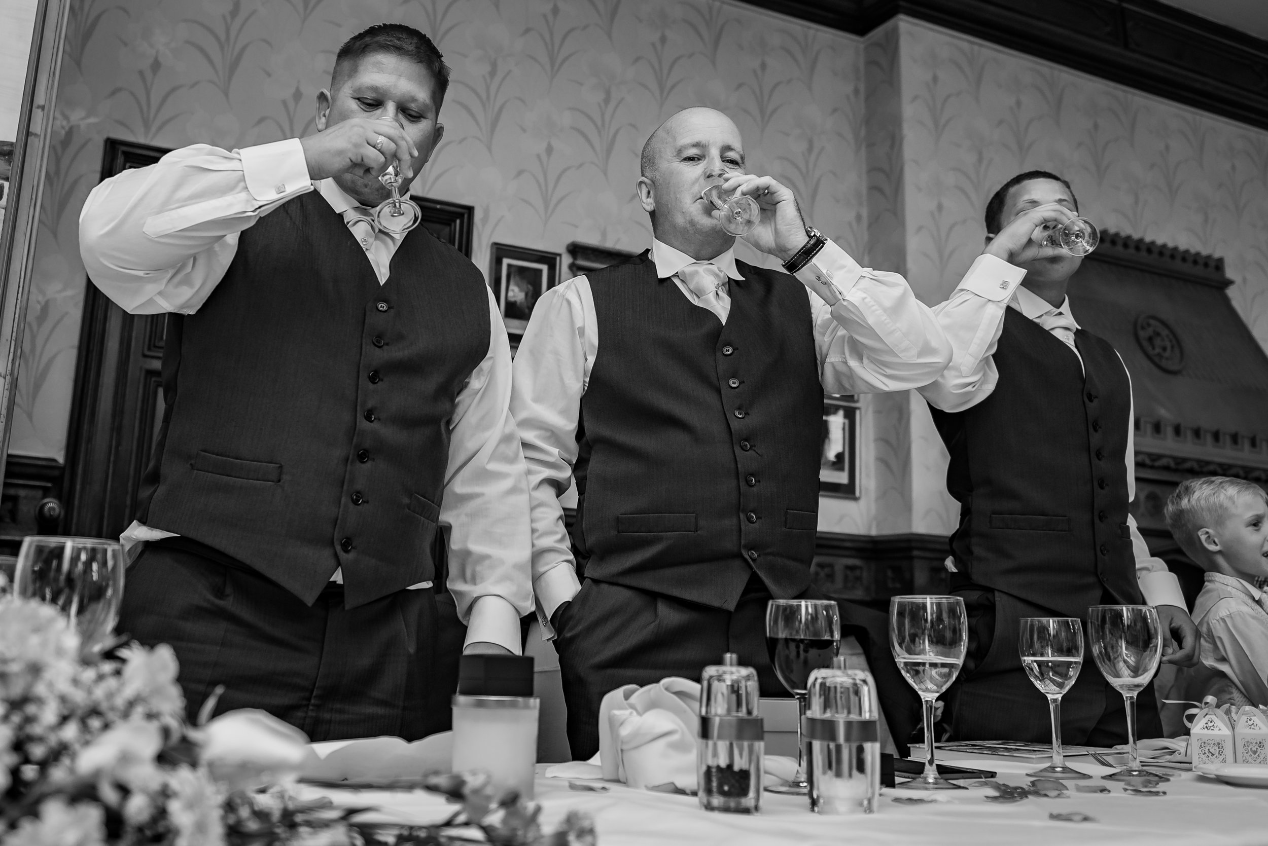 black and white wedding photography best man cheers