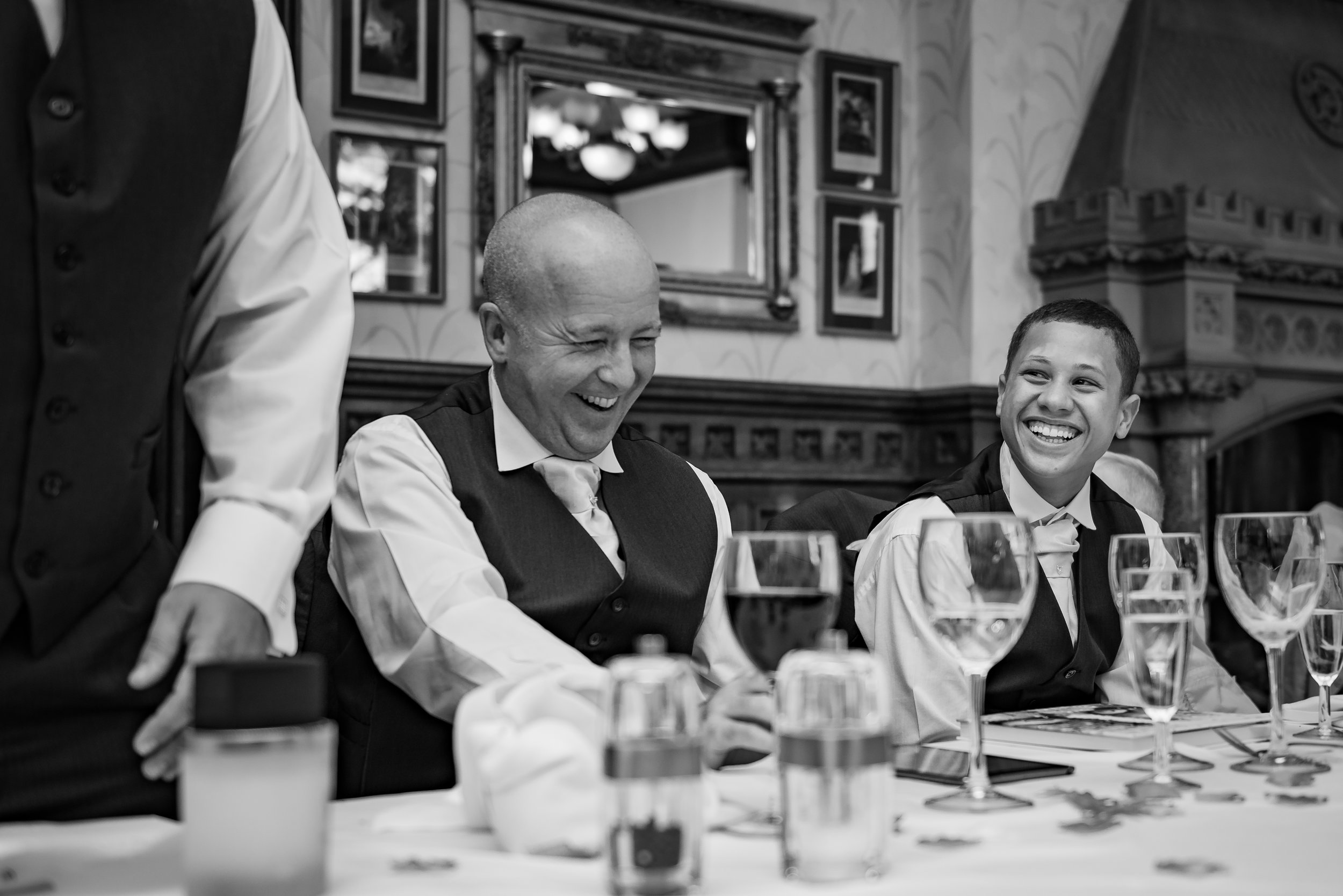 black and white wedding photography best man loving that one