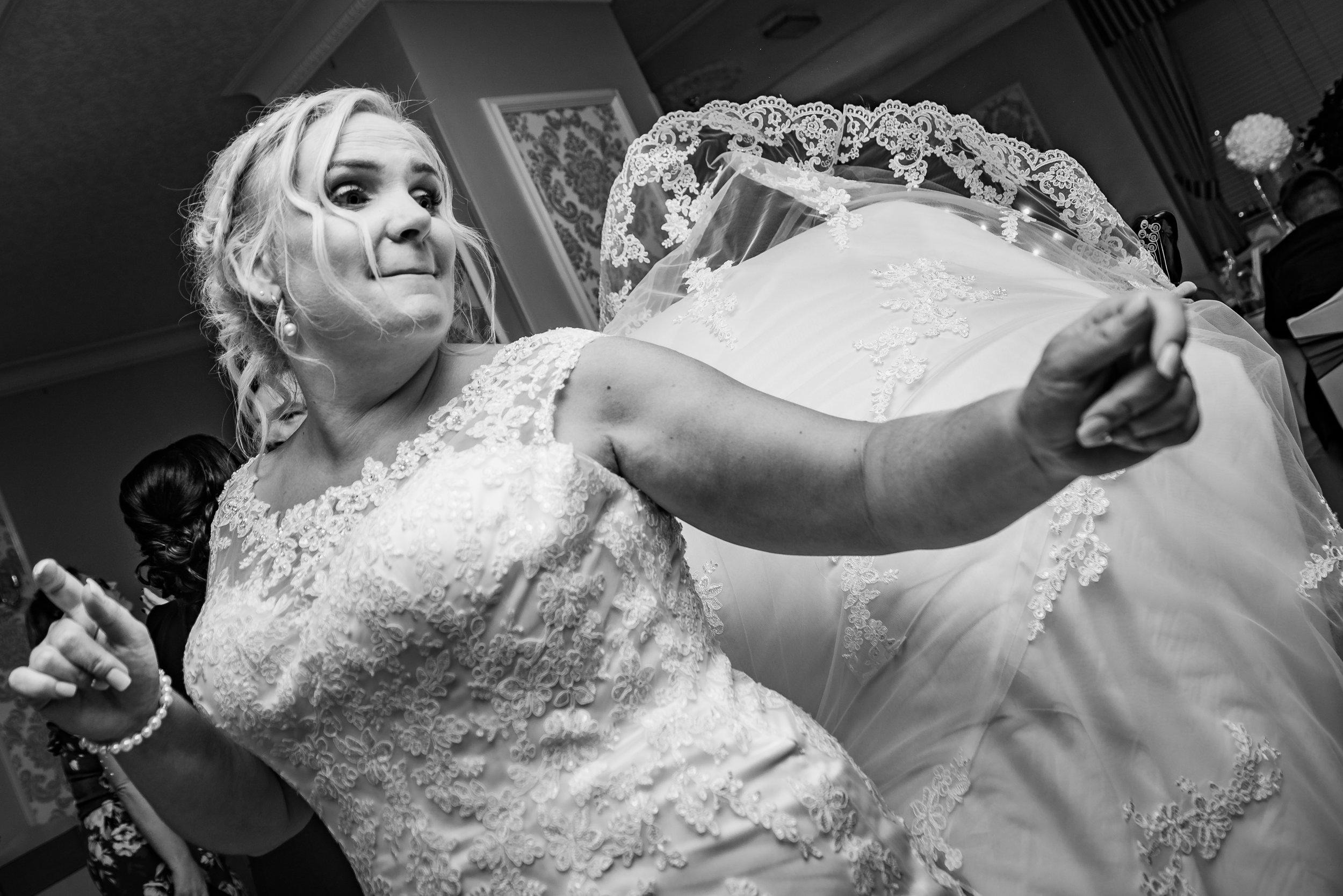 black and white wedding photography bride enjoying herself