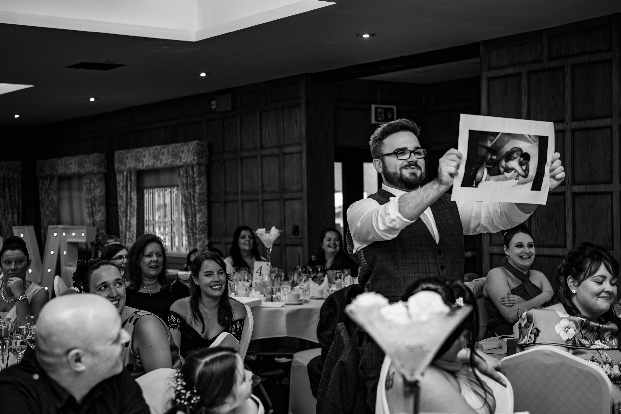 castle Bromwich hall hotel wedding photography natural black and white photography speeches best man with the worst photo of the groom