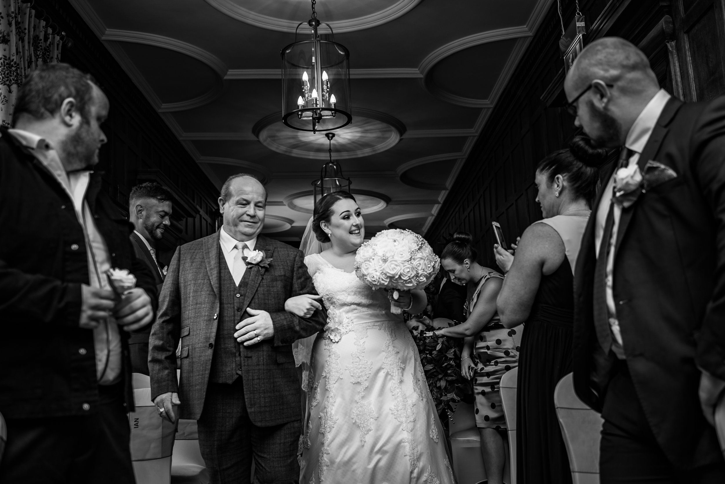 black and white wedding photography groom here comes the bride