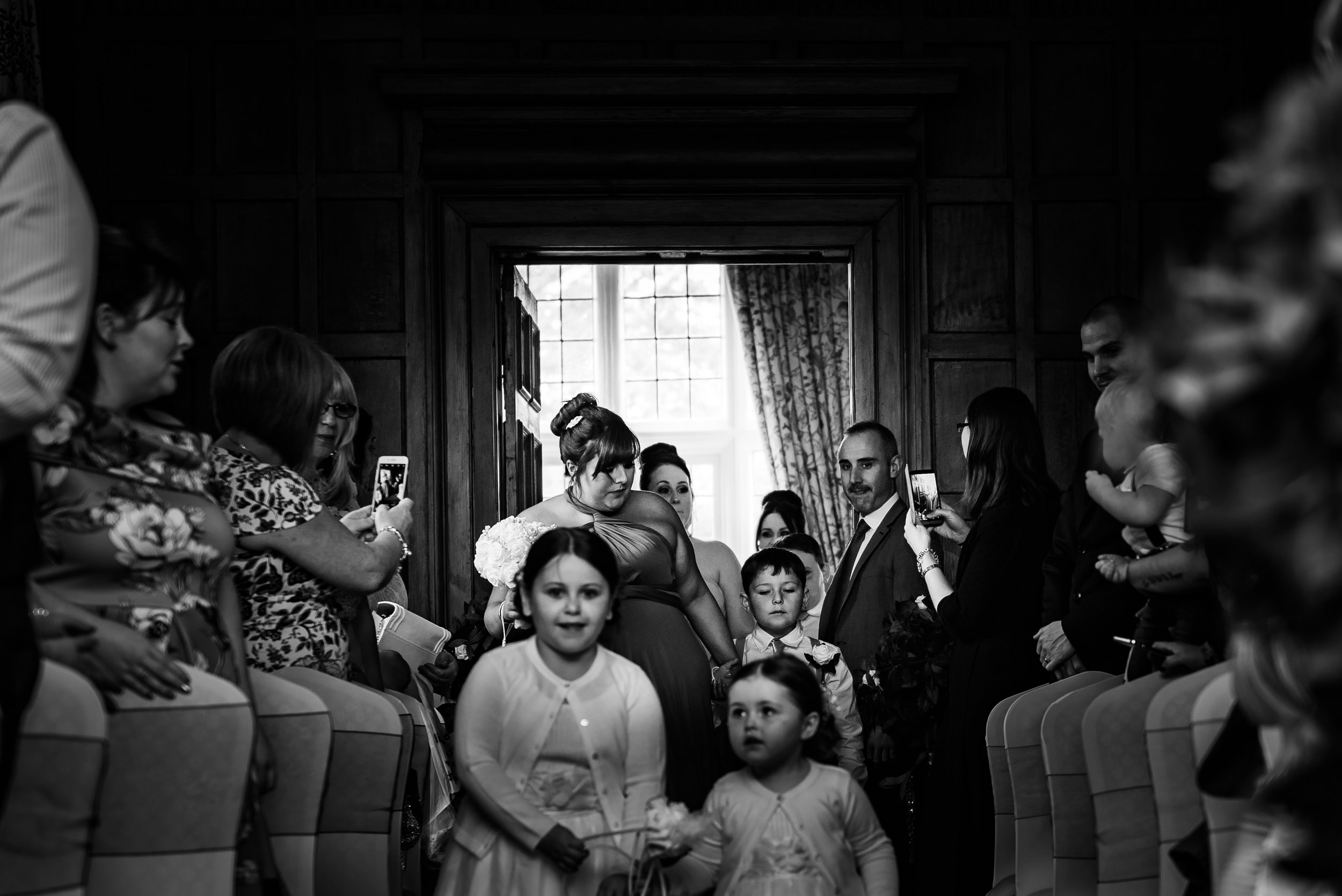 black and white wedding photography groom here comes the bridesmaids