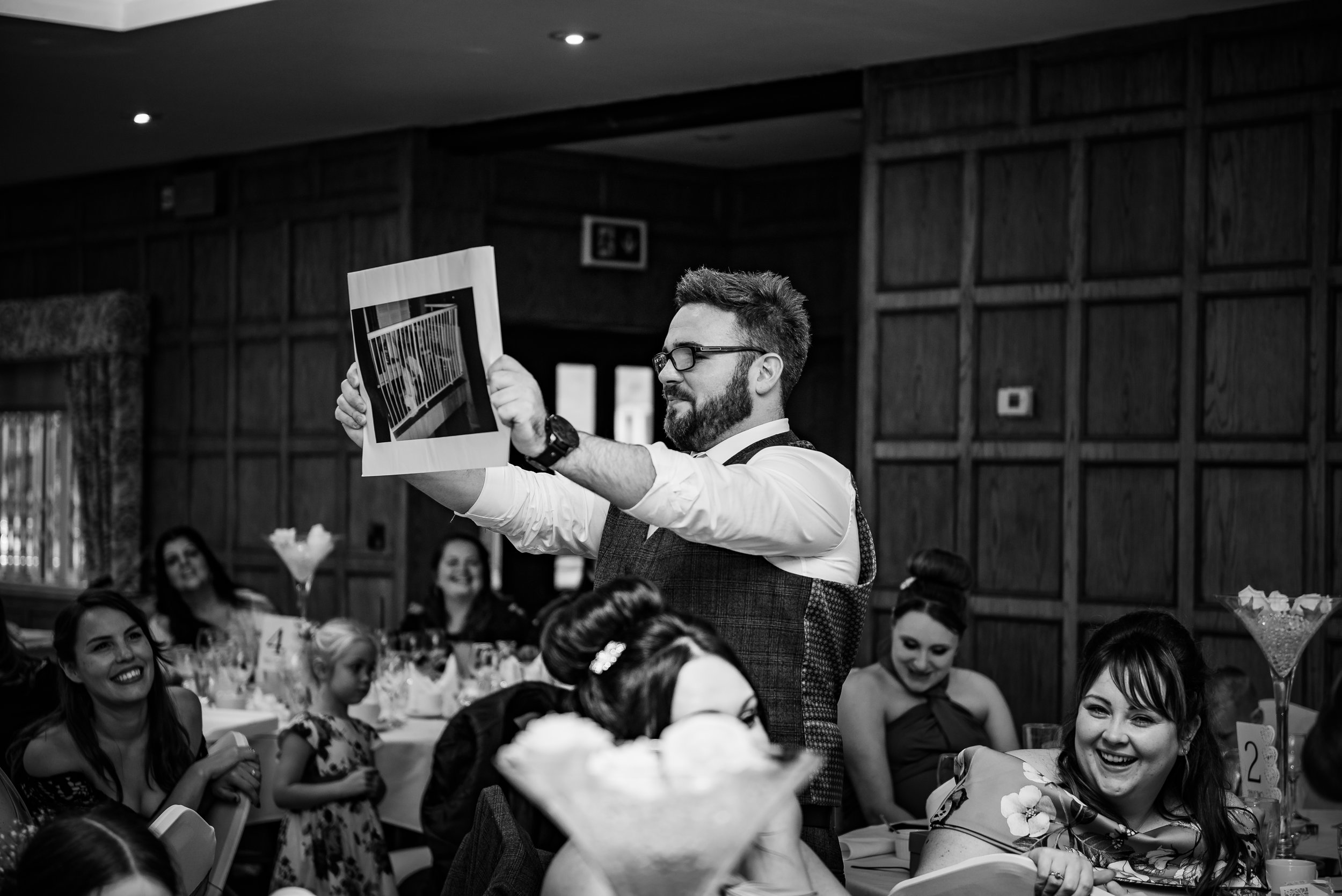 black and white wedding photography hilarious speech moment with groom photograph