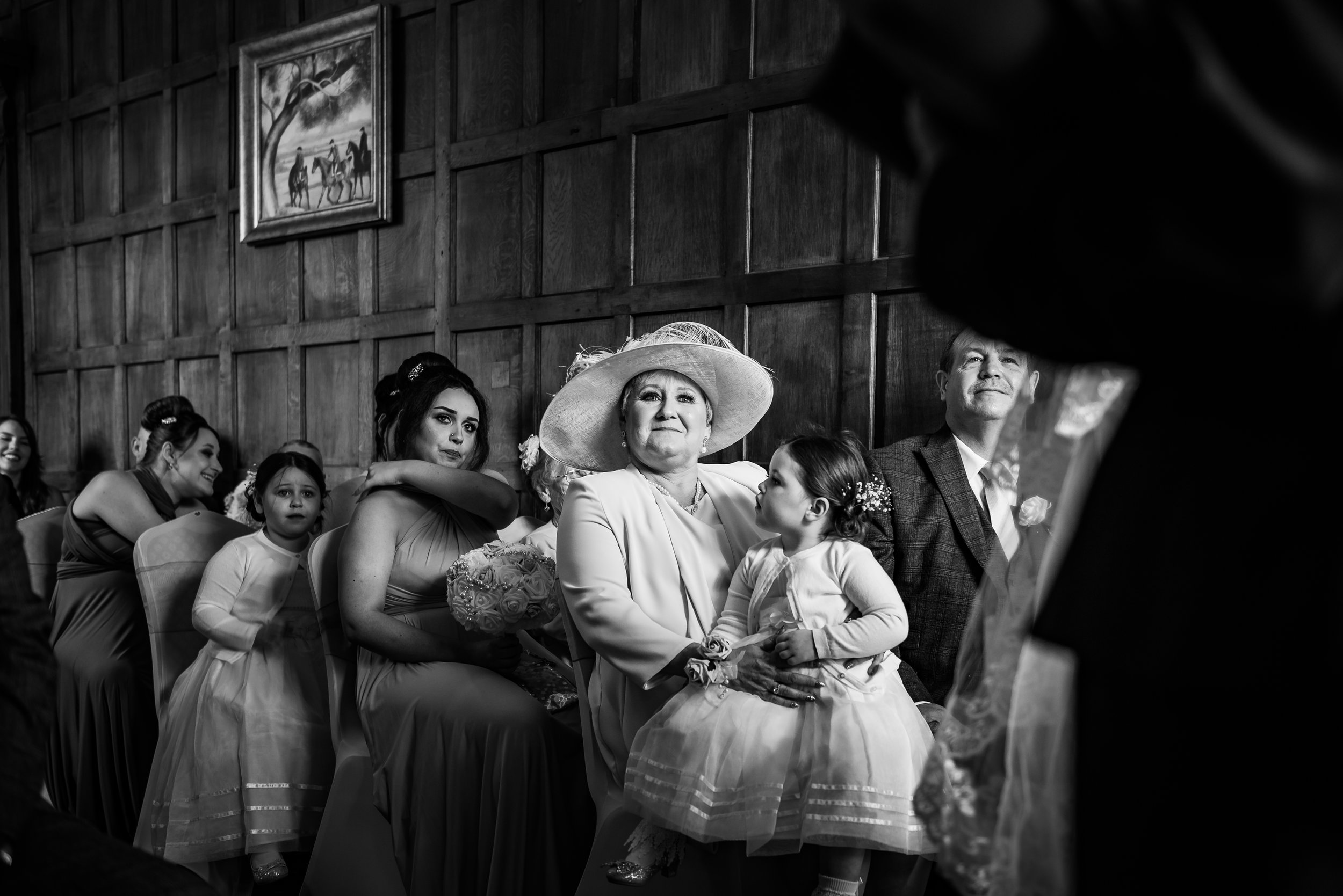 black and white wedding photography emotional mother of the bride guests