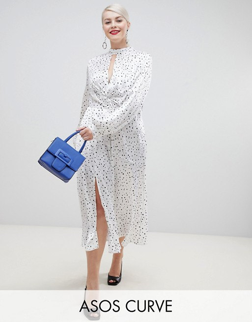 ASOS DESIGN Curve high neck twist front 70s sleeve maxi dress in spot , $67.00