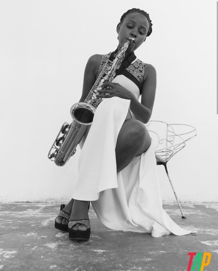 Stella Tushabe playing the Saxophone