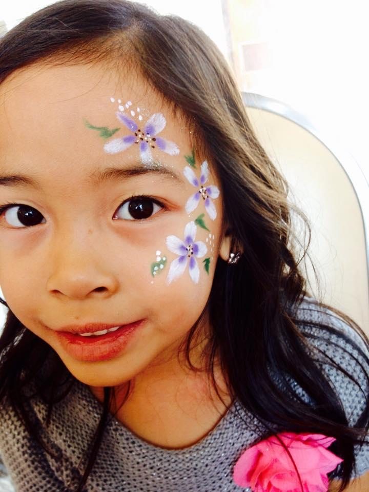 Facepaint Curly Qs flowers.jpg