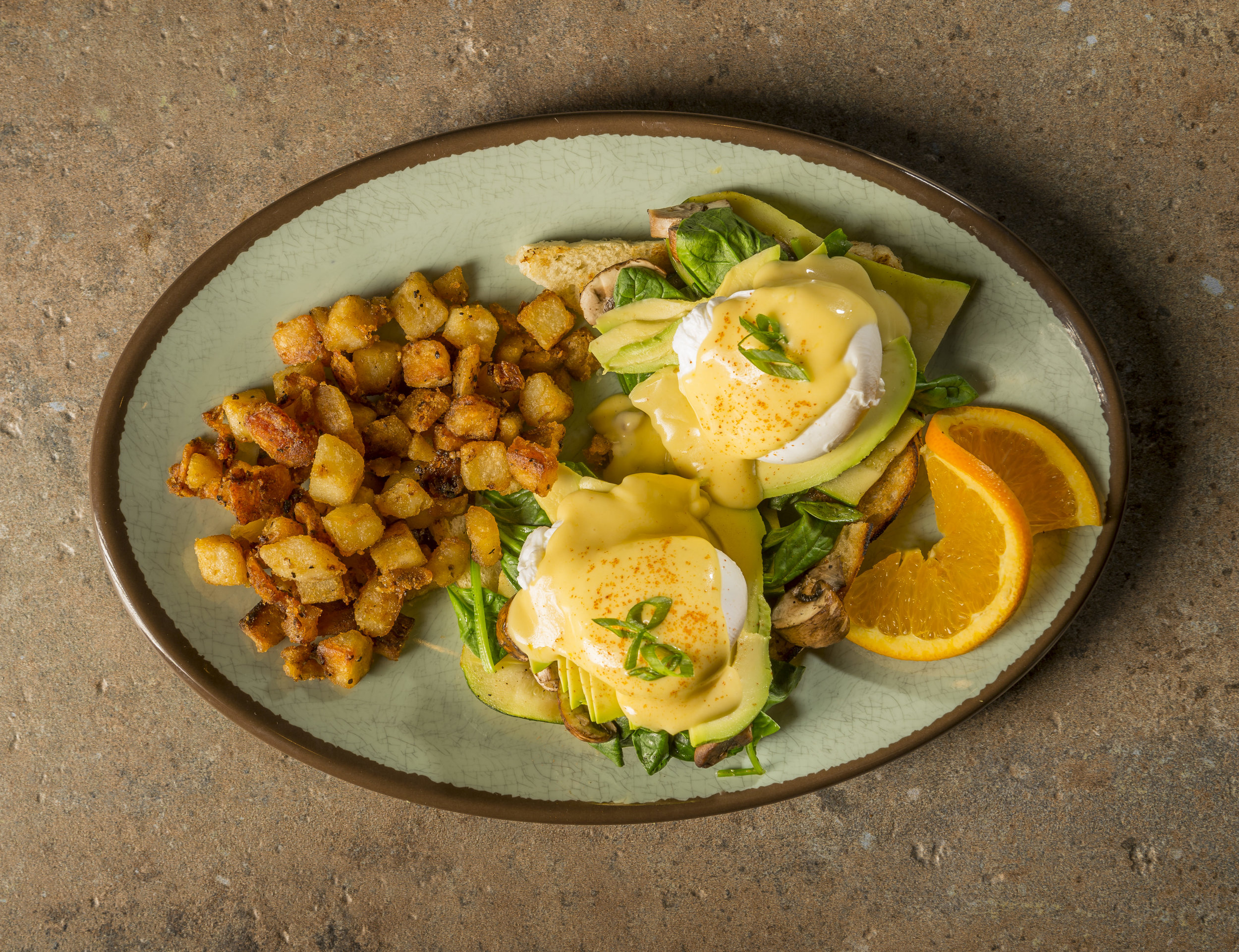 Veggie Benedict - Poached eggs, zucchini, mushrooms, spinach & avocado and Hollandaise on FTH sourdough.$9.99