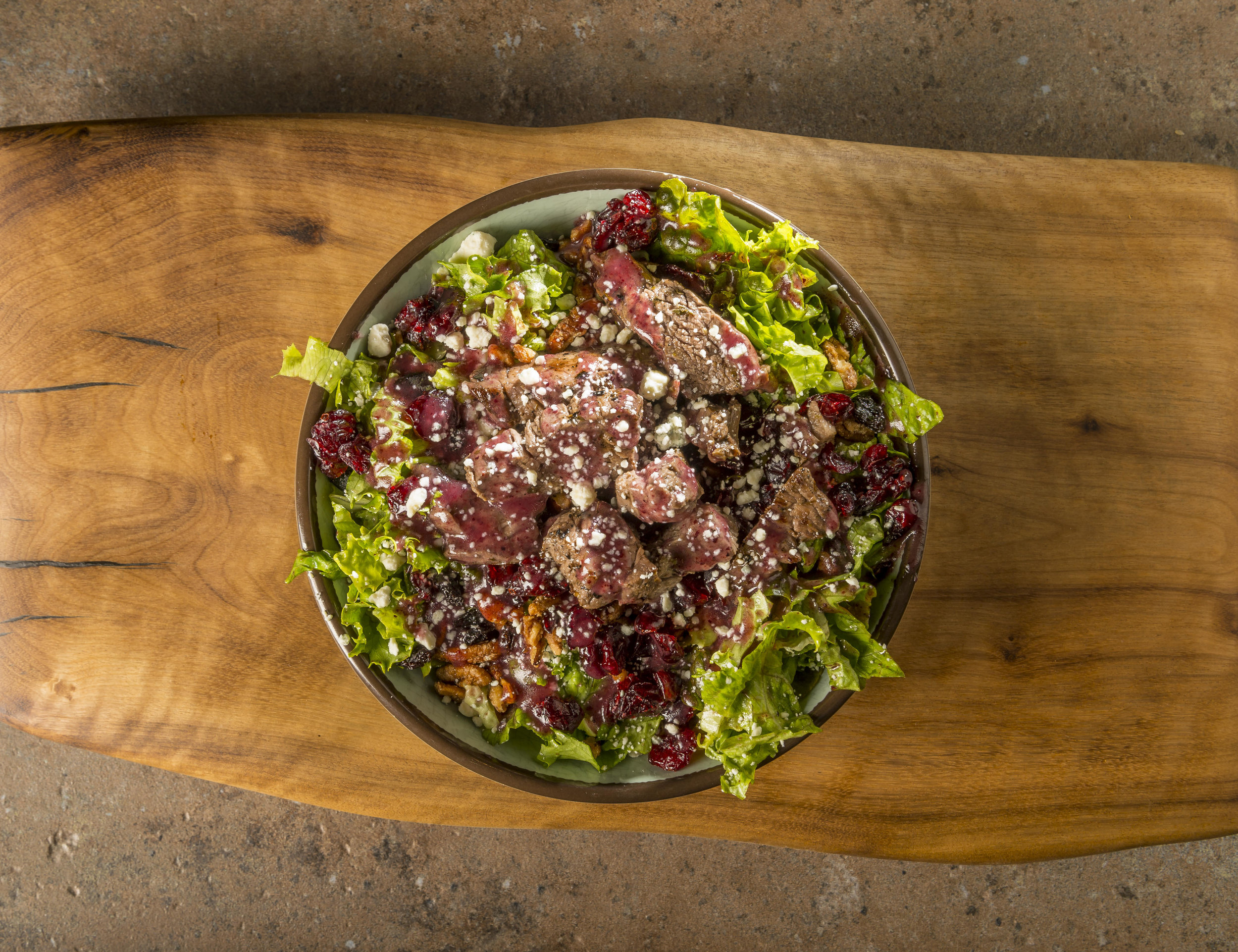 Black & Bleu - Marinated steak, candied pecans, dried cranberries, bleu cheese, and house-made blueberry-pomegranate dressing.$11.99