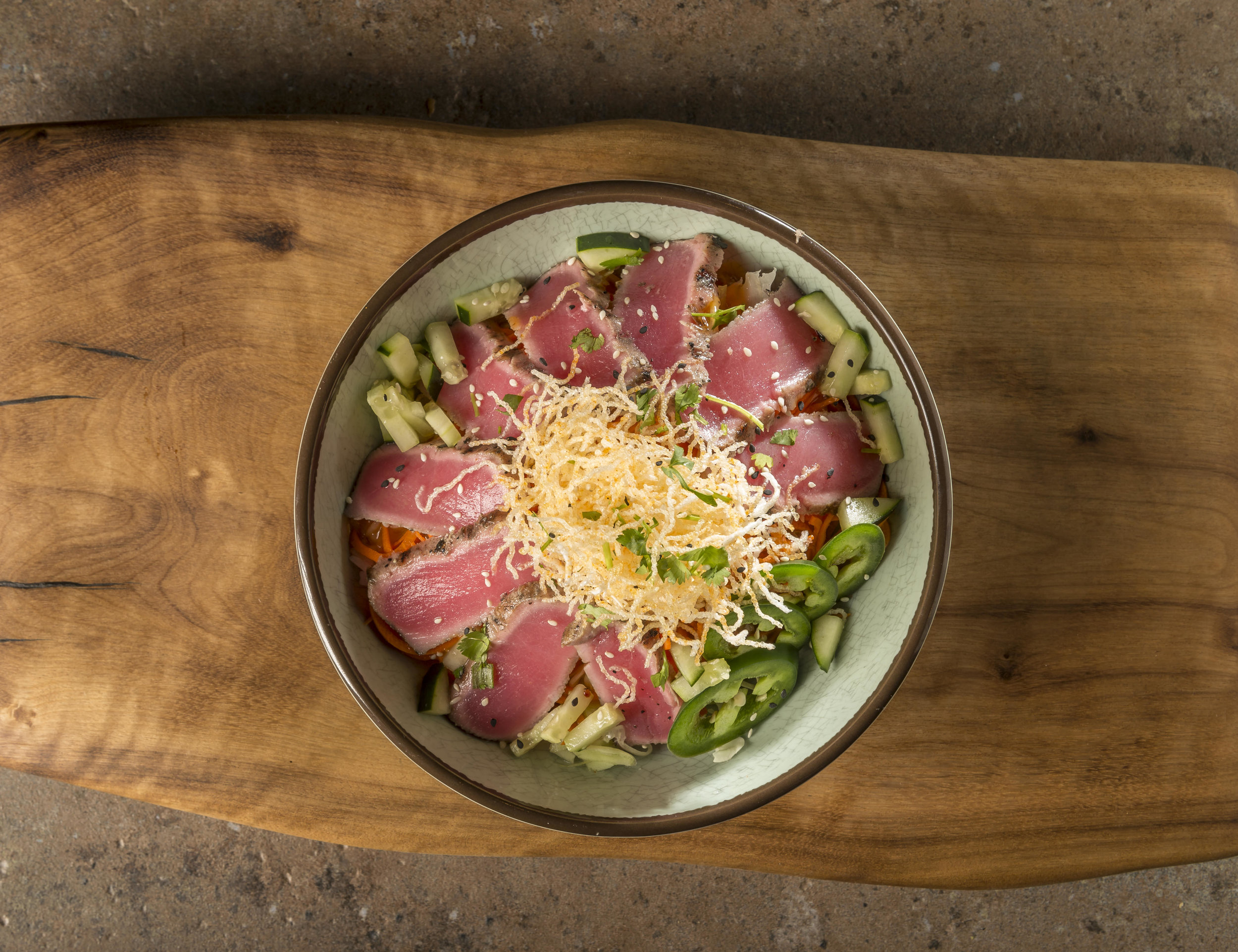Seared Ahi Bowl - Seared Ahi tuna, cabbage, carrot, cucumber, jalapeño, lime, and crunchy noodles with house-made spicy sesame dressing$12.49