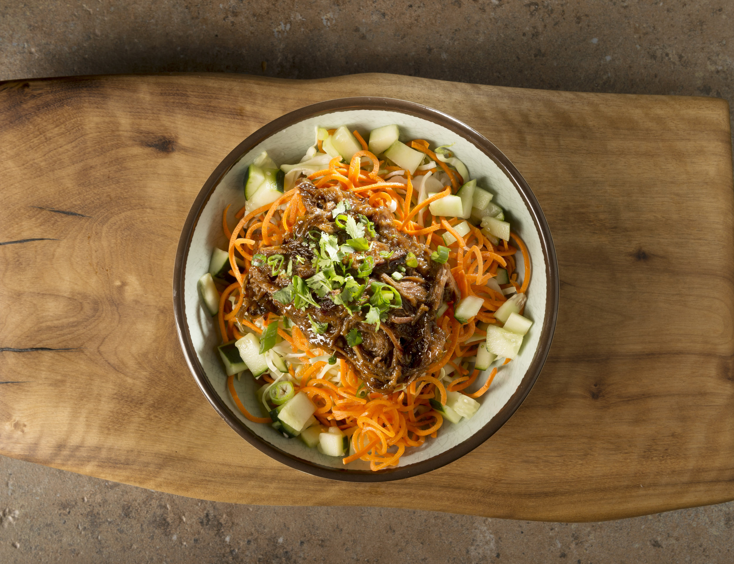 Yakuza Bowl - Slow-roasted pulled pork, marinated vegetables, cilantro, and green onions with house-made sweet soy sauce.$9.79