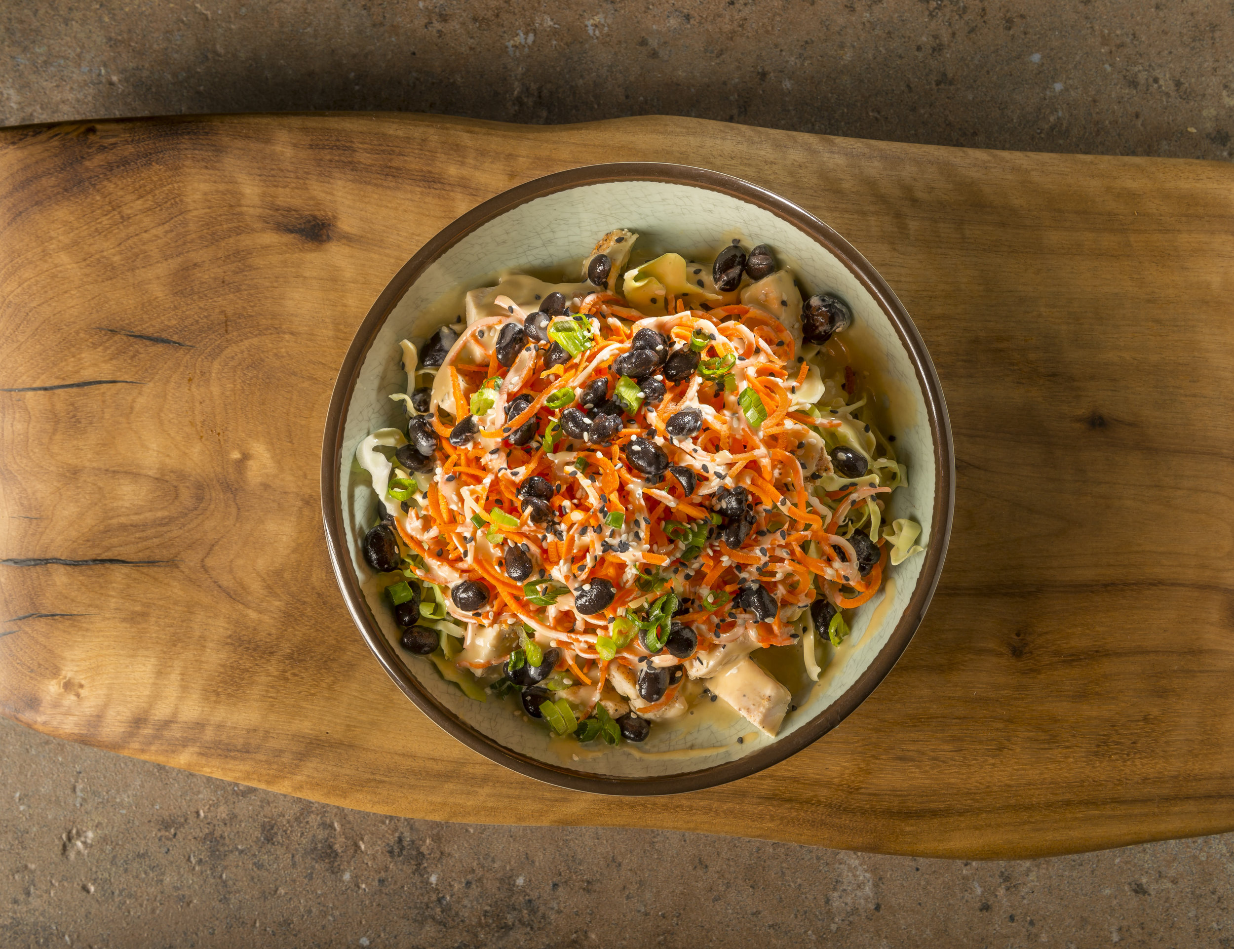 Chi Bowl - Choice of chicken or tofu, cabbage, carrots, black beans, green onions, sesame seeds, and house-made umami sauce.$9.59