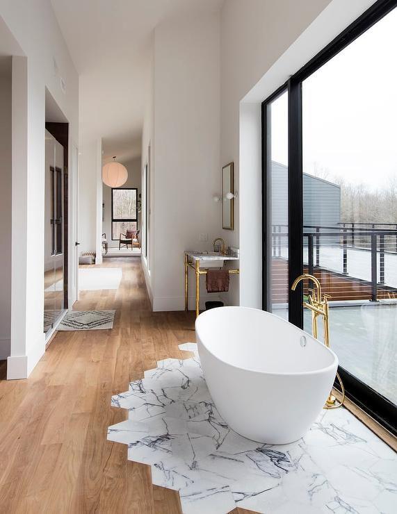 bathtub-on-marble-tiles-5a1f243f96f7d000191701b2.jpg