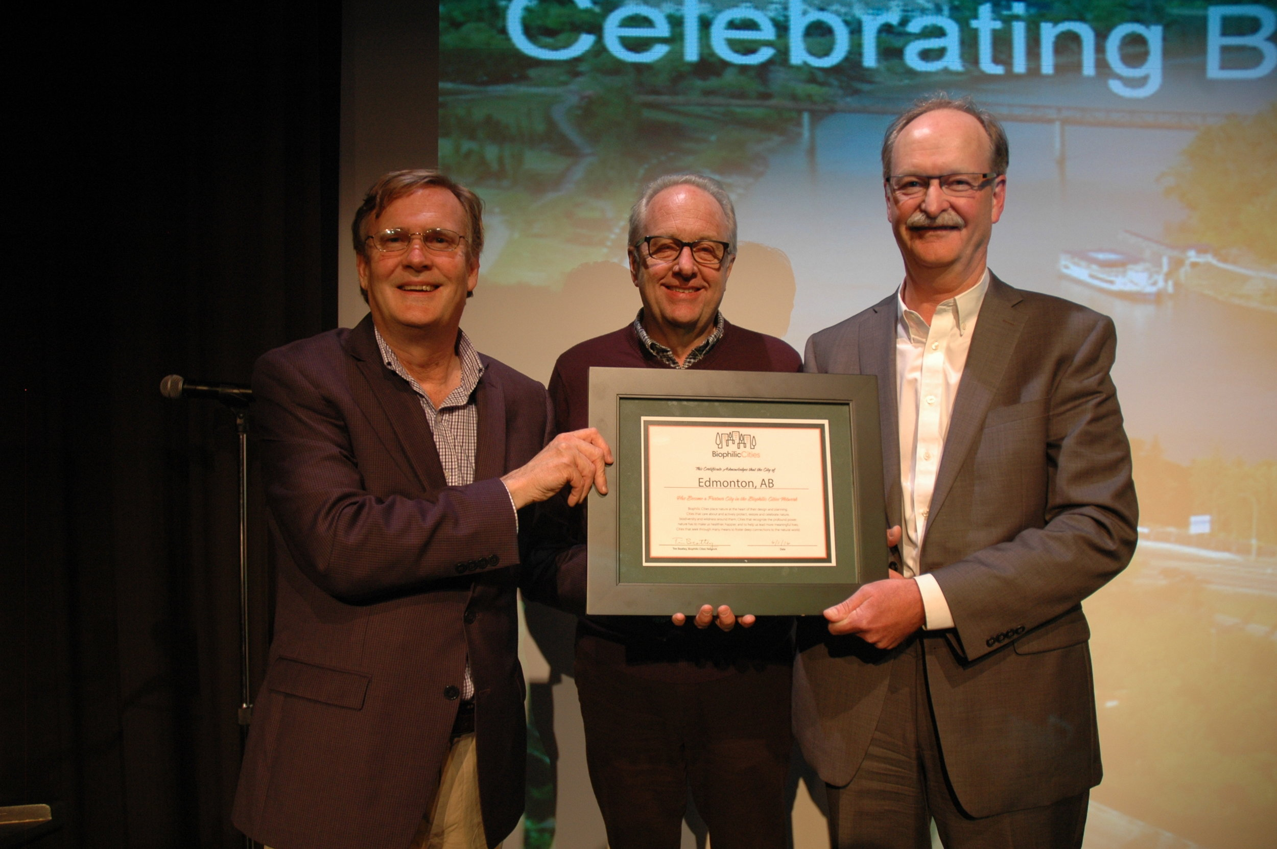 Tim Beatley Presents Network Certificate to Edmonton's Grant Pearsell and Peter Ohm