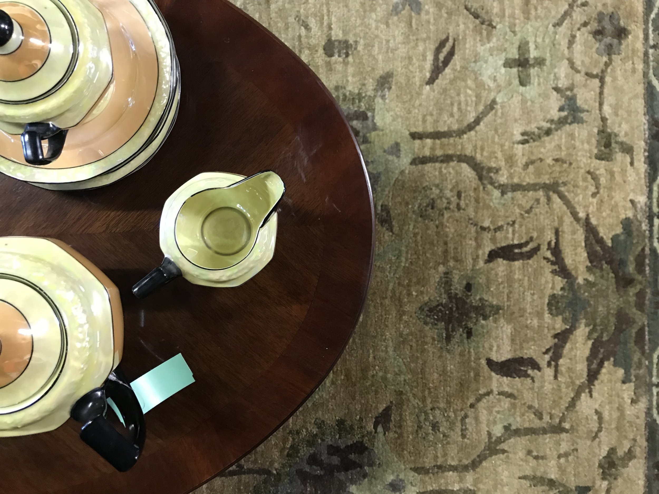 Hand knotted Nepali rug, vintage tea set and beautiful coffee table all for sale.