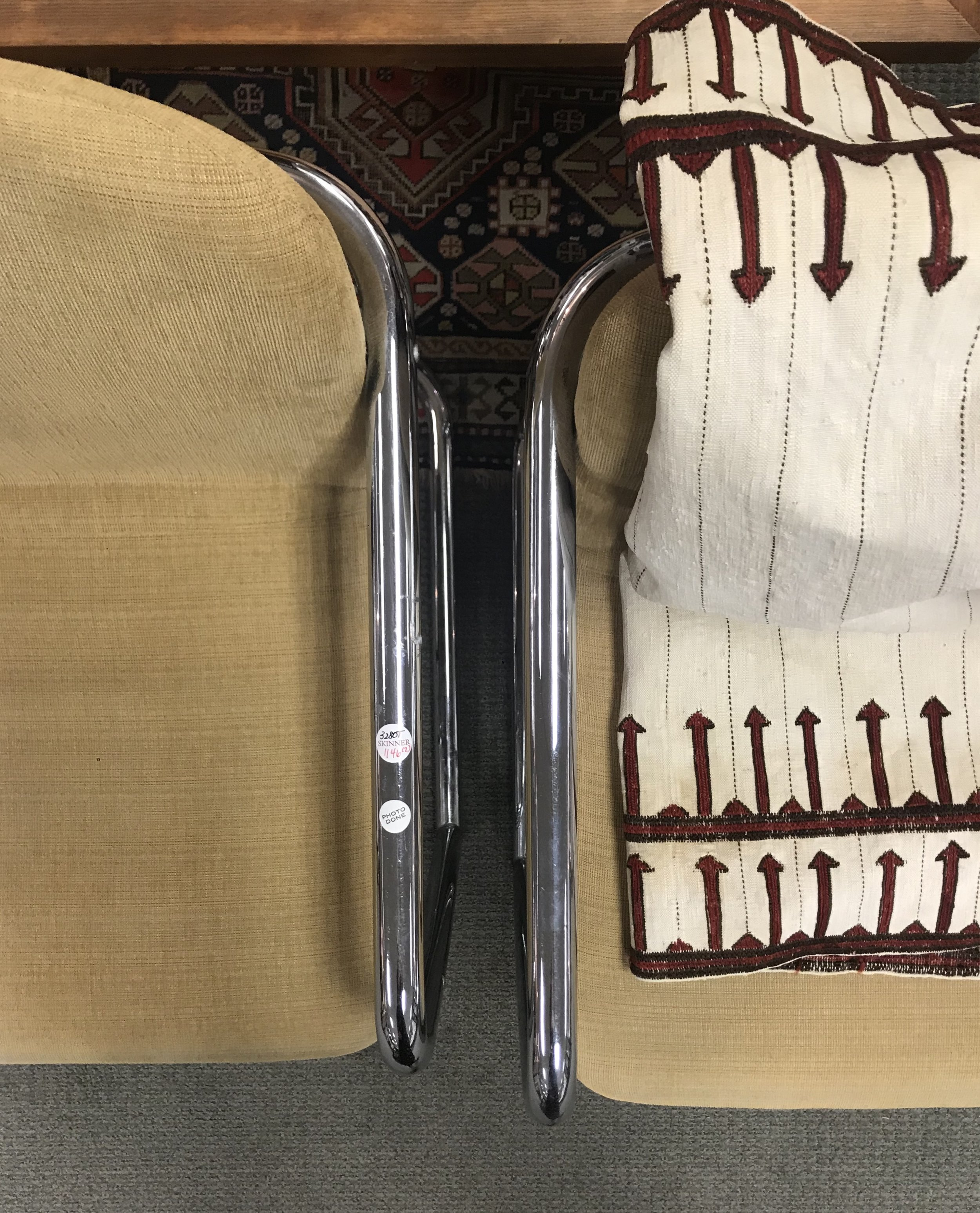 Modern Bent Steel Tube Armchairs and resting Antique Embroidered Textile from Iran.