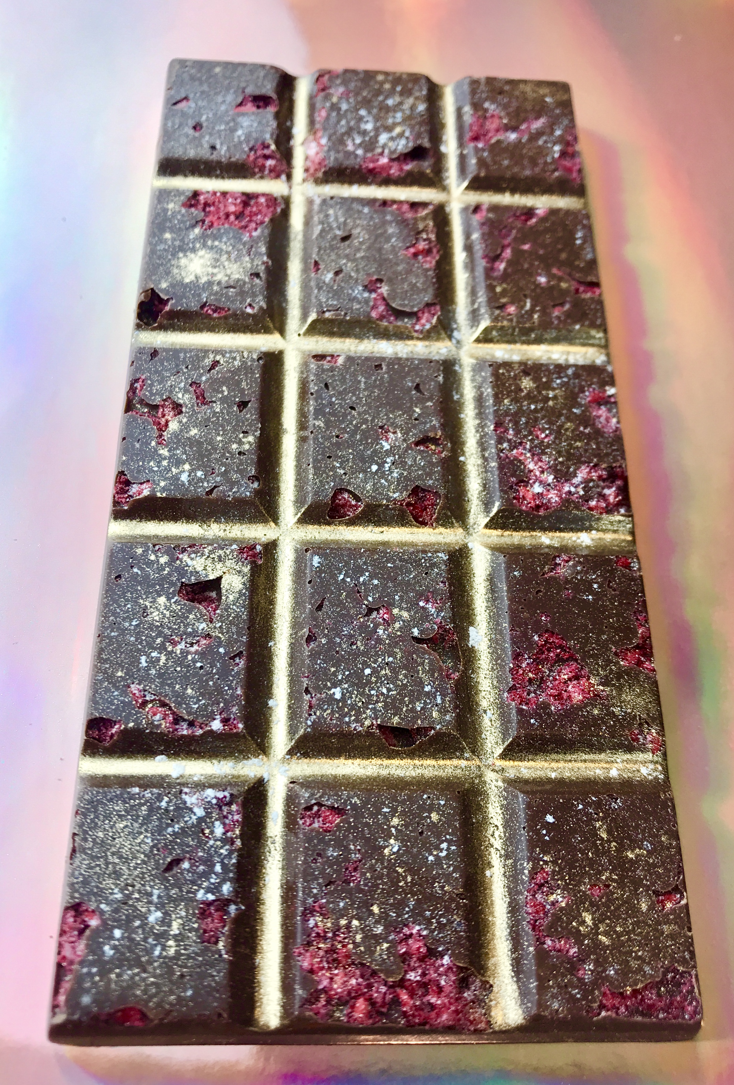 5. Radiant Raspberry Dark Chocolate - Experience Radiant Raspberry… The perfect combination of sweet & tart burst on your palette for a vibrant sensation like no other! Featuring Wild Red Raspberries in Raw Dark Chocolate Dusted with Pink Himalayan Salt & 24K Gold!