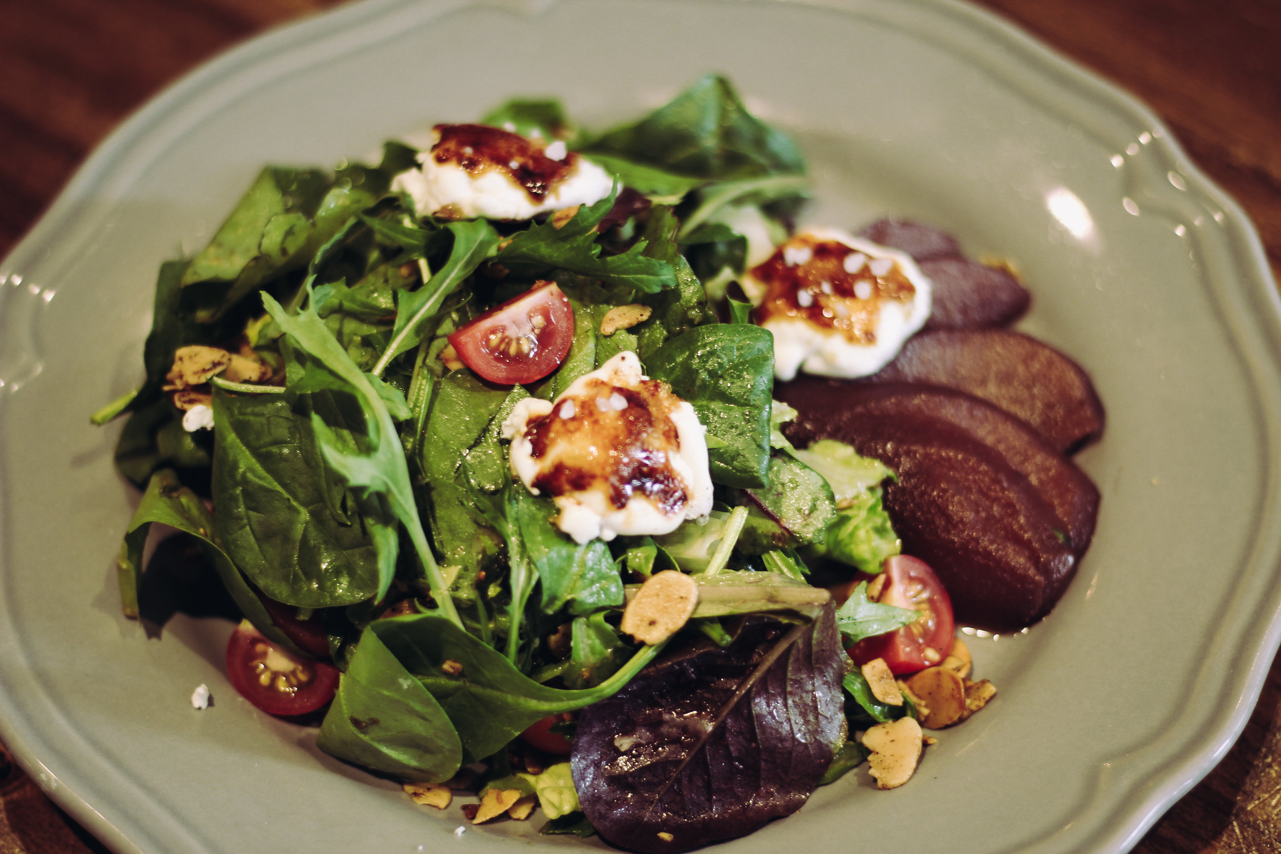 Local greens with fresh mozzarella and balsamic, topped with sea salt.