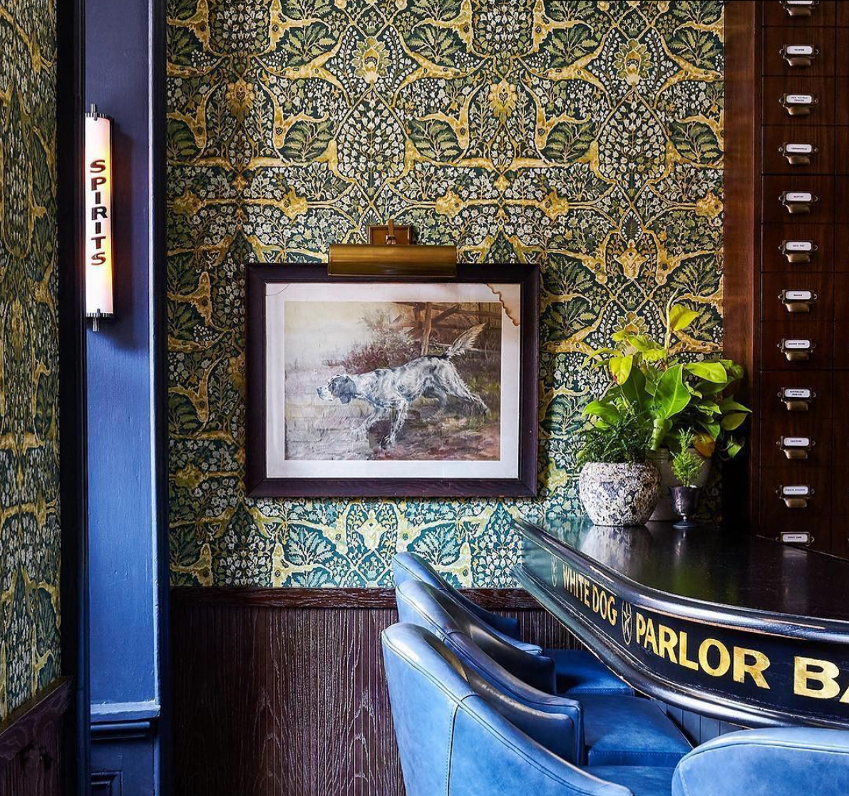 """At the bar with """"Alhambra"""" wide width wallpaper in verdure"""