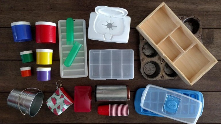 empty container laid out for toddler to fill with objects