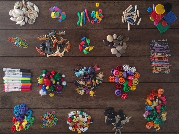 piles of colorful objects for toddler to play with